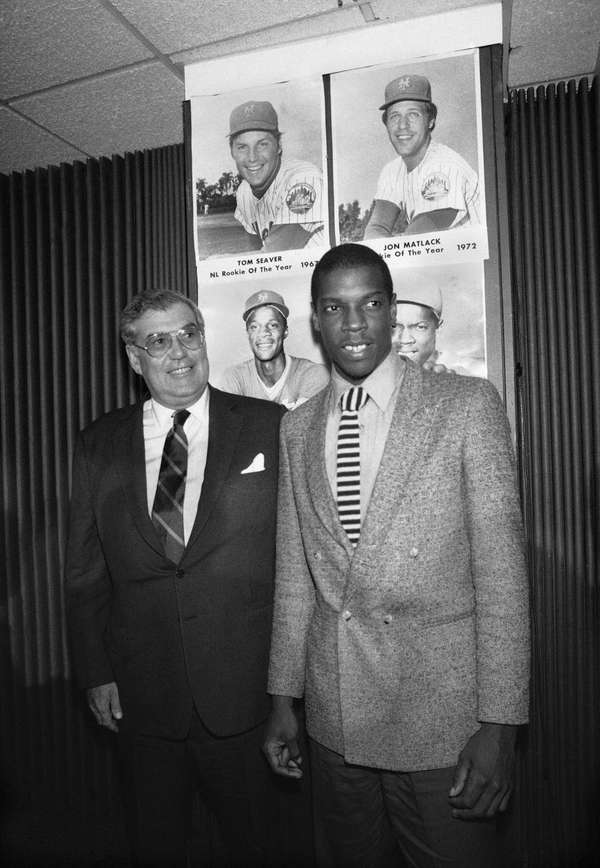 New York Mets pitcher Dwight Gooden, right, poses