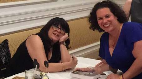 Gia Fabre, right, meets E.L. James, author of