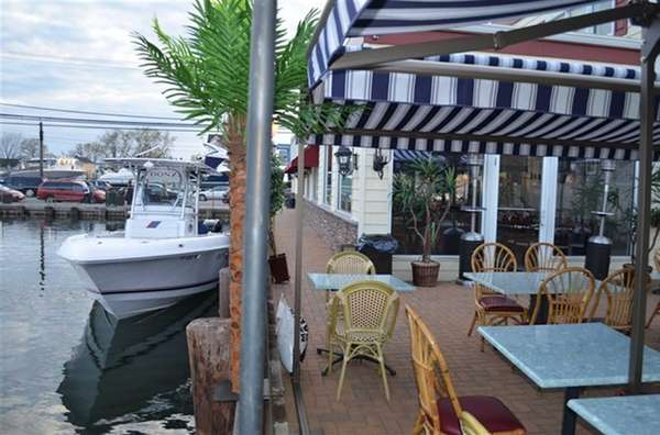 Dine on the patio overlooking the water at