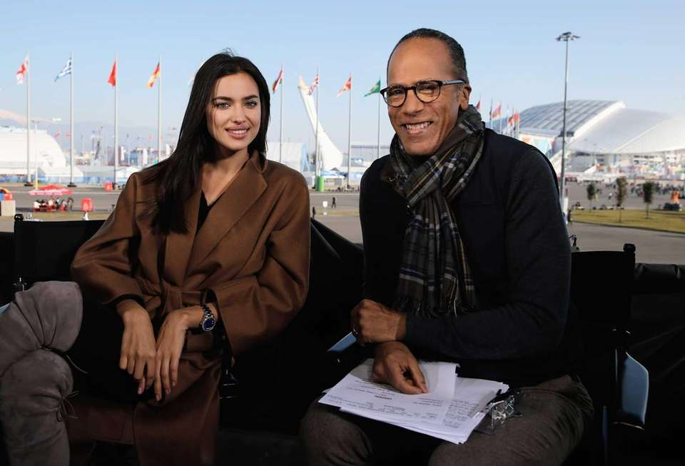 Russian model Irina Shayk poses with Lester Holt