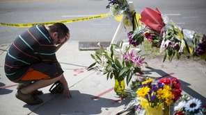 Noah Nicolaisen, of Charleston, S.C., kneels at a