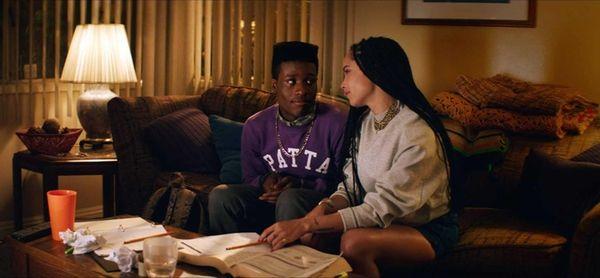 Shameik Moore and Zoe Kravitz in a scene