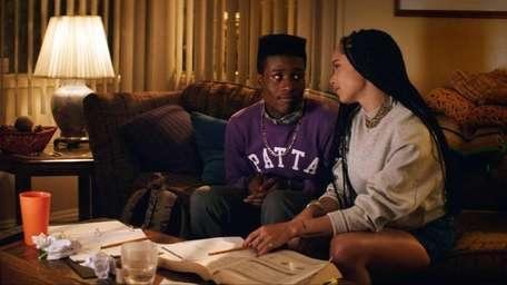 Shameik Moore and Zoe Kravitz in a scene