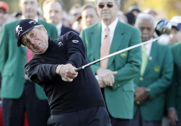 Gary Player hits a ceremonial drive on the