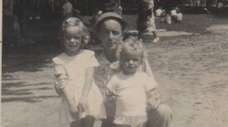 John Melia with daughters Kathy, then 5, and