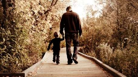 A father and son walking.