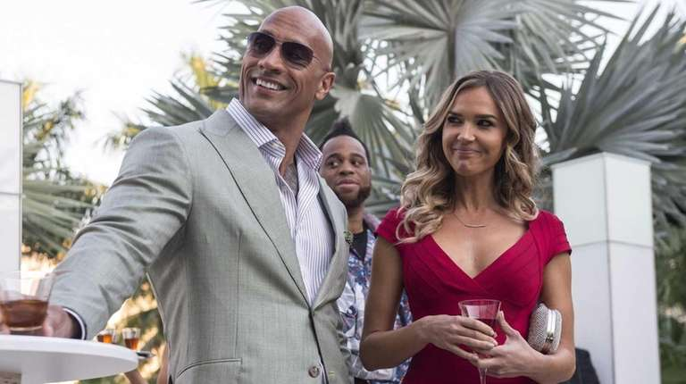 Dwayne Johnson, left, and Arielle Kebbel in a