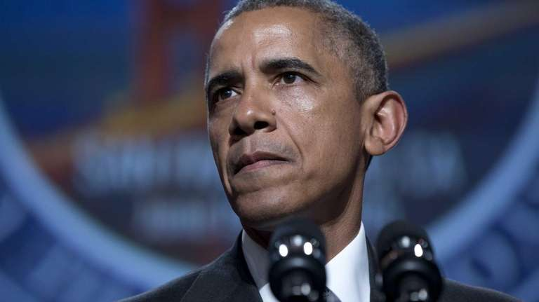 President Barack Obama pauses as he speaks at