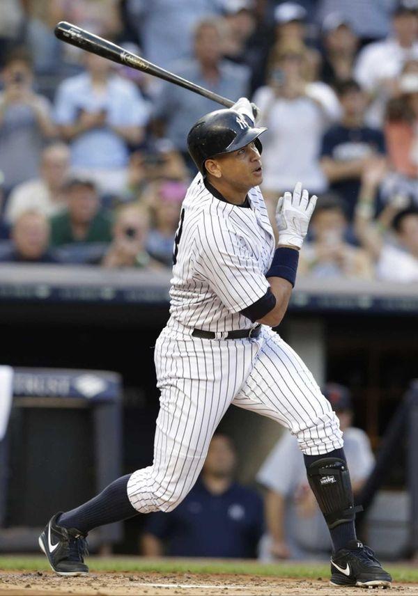 The Yankees' Alex Rodriguez follows through on a