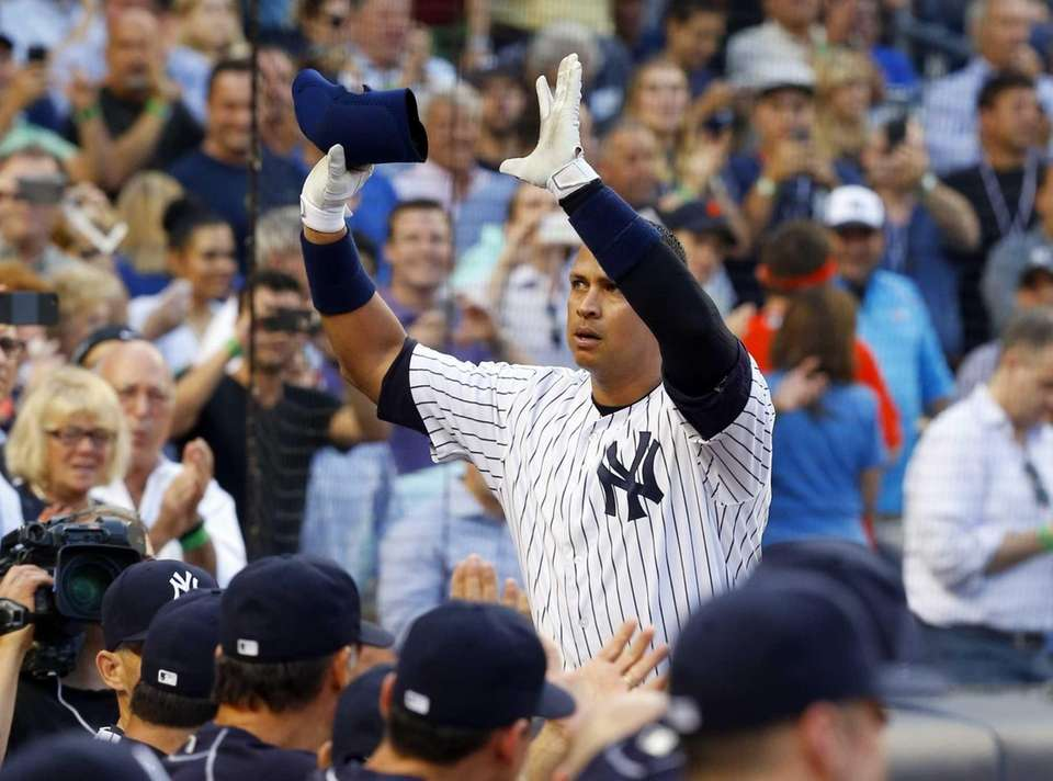Alex Rodriguez #13 of the Yankees salutes the