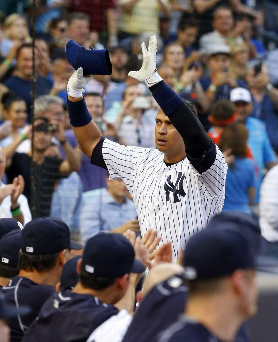 Alex Rodriguez of the Yankees salutes the fans
