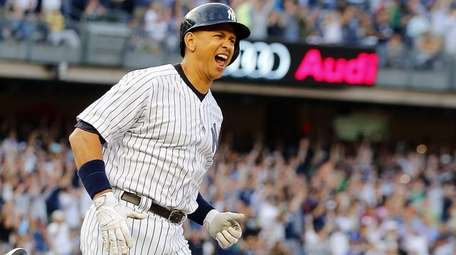 Alex Rodriguez #13 of the Yankees reacts after