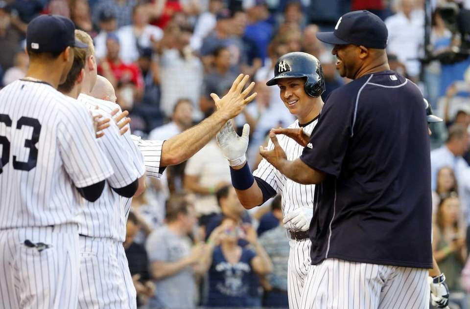 Alex Rodriguez of the Yankees celebrates career hit