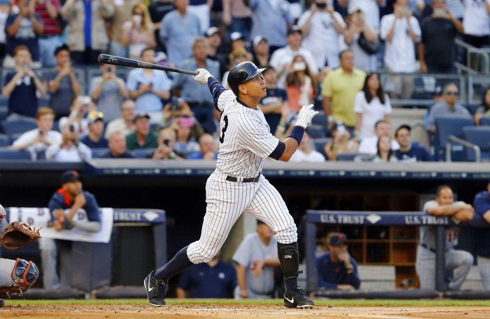 Alex Rodriguez #13 of the Yankees follows through