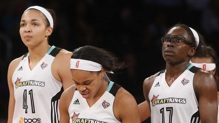 Liberty teammates, from left, Kiah Stokes, Brittany Boyd