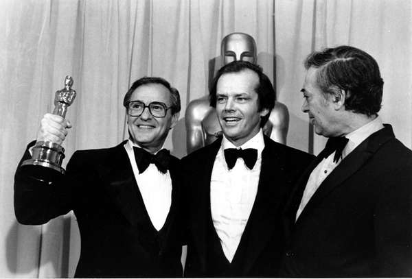 Producer Charles Joffe, holding the Oscar, actor Jack