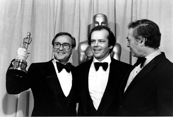 Producer Charles Joffe, holding the Oscar, actor Jack