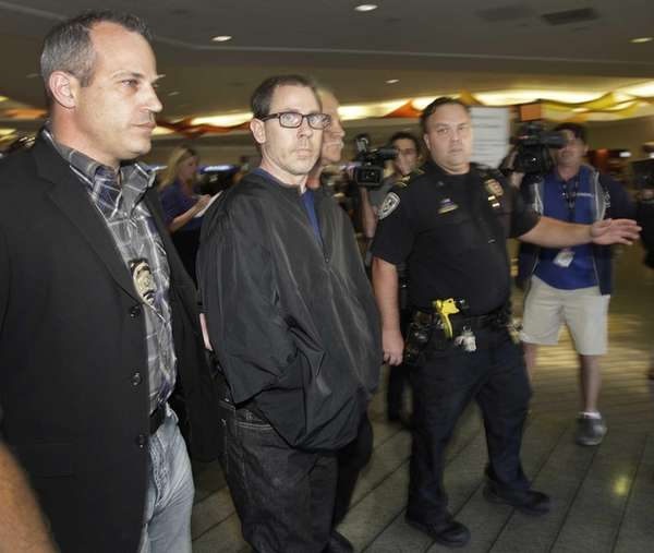 Terry Speaks, center, a suspect in the