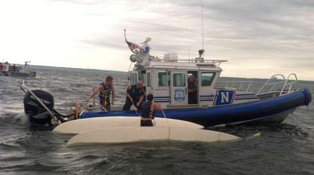 Suffolk County Police Marine Bureau officers, with assistance