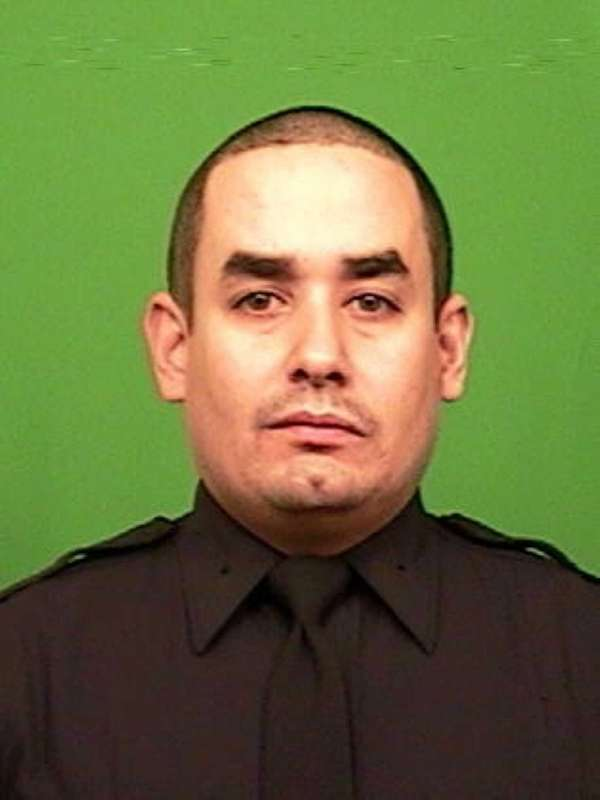New York Police Officer Rafael Ramos (pictured) was