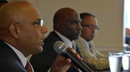 Dr. Kishore Kuncham, superintendant of Freeport Schools, left,