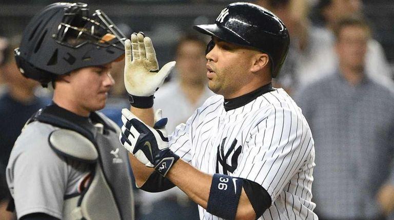New York Yankees rightfielder Carlos Beltran reacts after