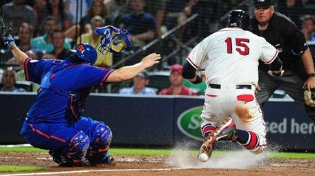 A.J. Pierzynski of the Atlanta Braves scores on