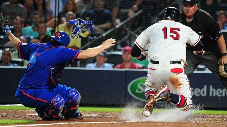 A.J. Pierzynski of the Atlanta Braves scores on