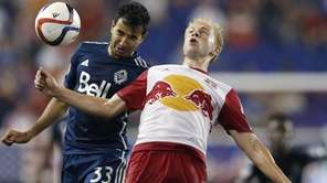 Vancouver Whitecaps FC defender Steven Beitashour, left, and