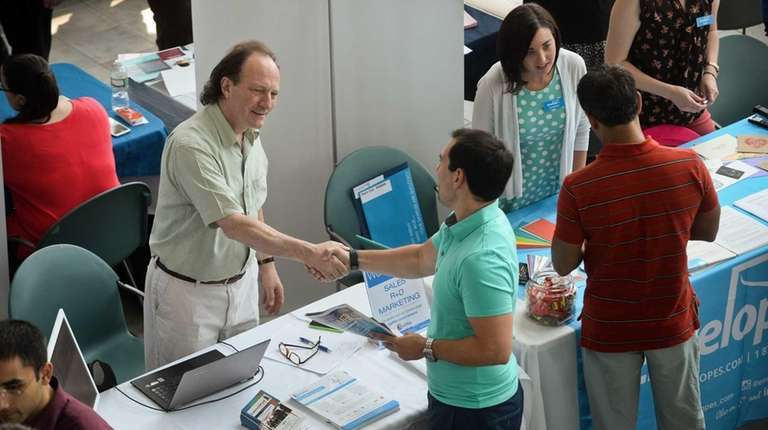 Philip Rugile, from eGifter, greats a visitor during
