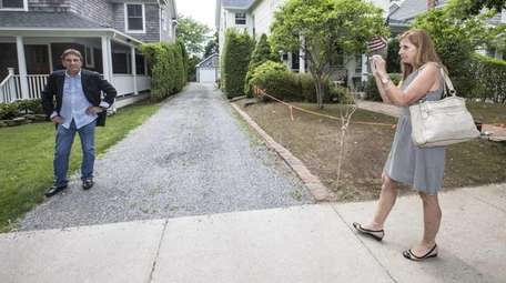 Anthony Gugliotta stands by his home in Southampton