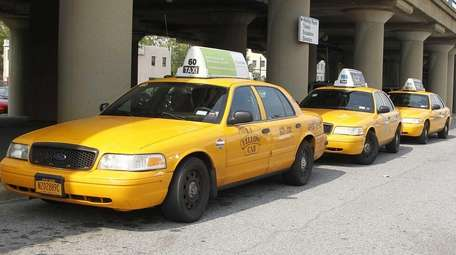 Taxis wait at the Hicksville LIRR station on