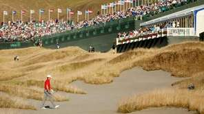 Jordan Spieth of the United States walks across