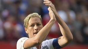 The United States' Abby Wambach celebrates her team's