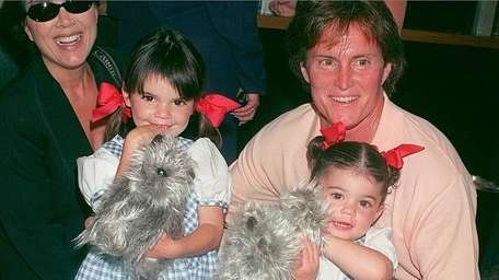Caitlyn Jenner, before her transition, with wife Kris
