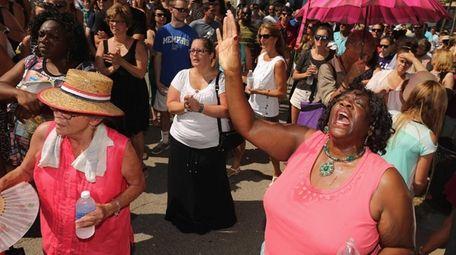 Debra Johnson, right, of Atlanta, Georgia, sings gospel