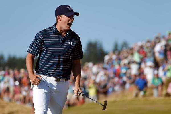 Jordan Spieth celebrates a birdie putt on the