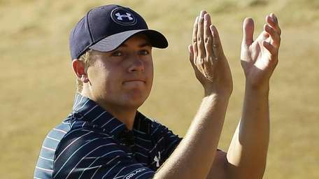 Jordan Spieth claps after finishing the final round