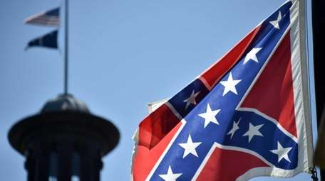 The South Carolina and American flags fly at