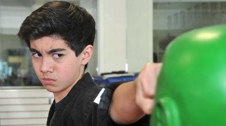 Aidan Considine, 13, shows off his martial arts