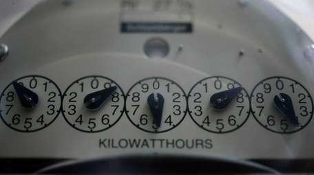 An old electric meter on sits on a