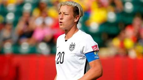 Abby Wambach of the United States looks on