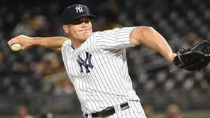 New York Yankees relief pitcher Branden Pinder delivers