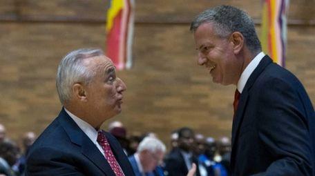 Police Commissioner William J. Bratton greets New York