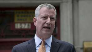 New York Mayor Bill de Blasio speaks at