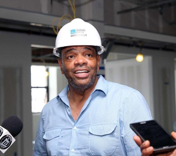 Brooklyn Nets head coach Lionel Hollins talks to