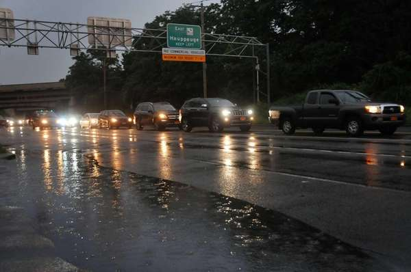 Cars drive down Glen Cove Road in Westbury
