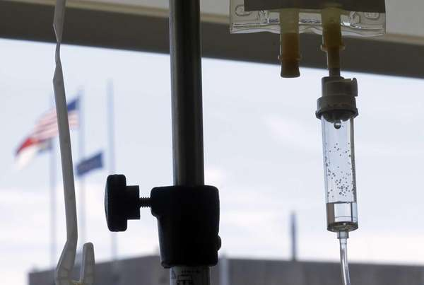 Chemotherapy is administered to a cancer patient via