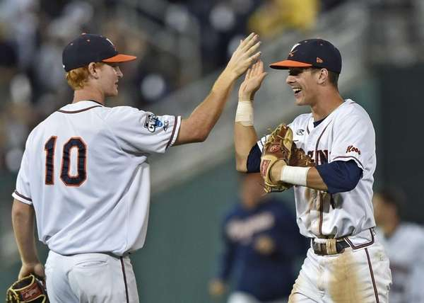 Pavin Smith #10 and Ernie Clement #4 of