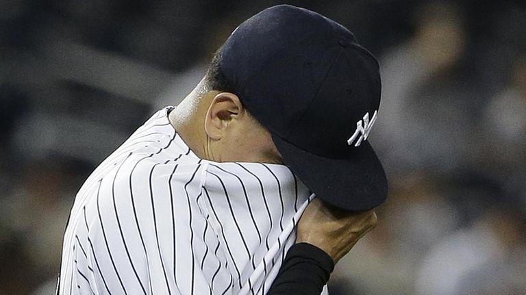New York Yankees pitcher Dellin Betances wipes sweat